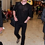 Chris Hemsworth arrived at Sydney's airport wearing an all-black outfit.