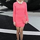 Leigh Lezark took a brighter approach at Chanel in a coral minidress, a matching Chanel clutch, and a chunky pearl necklace.