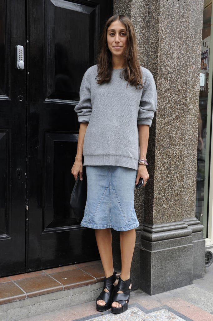 A structural gray sweatshirt worn with a trumpet-hem denim skirt? We're in.