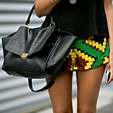 An ultraluxe Céline tote paired up nicely with high-impact shorts.