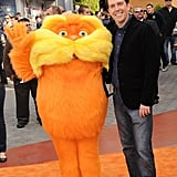Ed Helms and the Lorax posed for the press at The Lorax premiere.