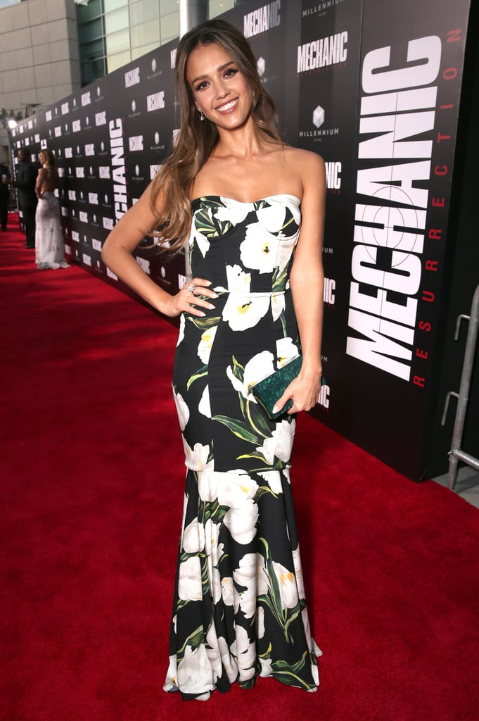 All eyes were on Jessica Alba at the premiere of her new movie, Mechanic: Resurrection, in Los Angeles on Aug. 21. The actress and The Honest Company founder, who will release a new line of hair care products this Fall, clipped in some long and flowy extensions to accentuate the strapless detail of her statement floral Dolce & Gabbana dress, resulting in a show-stopping look that required minimal accessories. Jessica simply paired the designer gown with dainty earrings, a turquoise clutch, and her signature Honest Beauty glowy makeup. Keep scrolling for more pictures of Jessica and shopping suggestions to copy her look. Then, admire her best street style moments so far this year.