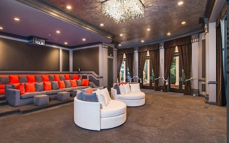 The 6,000-square-foot movie theater is full of fashionable details, such as the glam crystal lighting and plush seating.