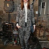 Coco Rocha's printed pantsuit and orange lipstick popped backstage at Helmut Lang.