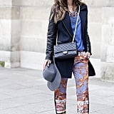 This showgoer gave her printed trousers just the right touch with a simplified coat and solid blue tee.