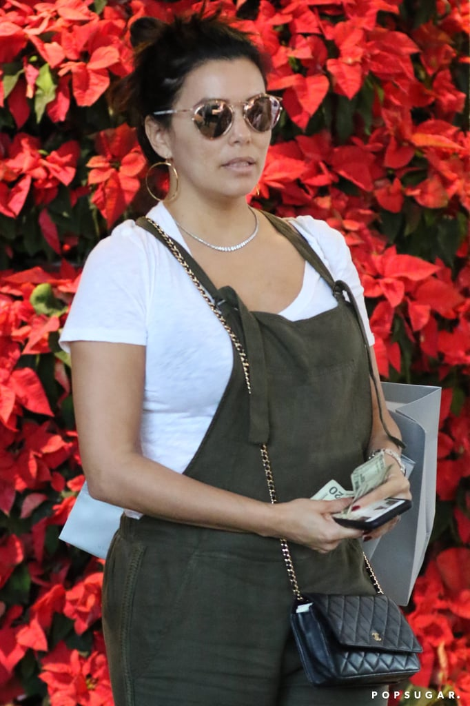 "New broke on Tuesday that Eva Longoria is expecting her first child, a baby boy, with husband Jose ""Pepe"" Baston, and on Friday, we finally got a glimpse of her growing belly. The actress, who wed the Televisa executive back in May 2016, was spotted doing some last-minute Christmas shopping in Miami and covered up her baby bump in olive overalls. Even though Eva has yet to publicly address her pregnancy, she did seemingly hint at it shortly after the reports surfaced when she posted a photo of herself on Instagram and captioned it, ""Pure Happiness 😊."" Given that Eva is the godmother to pal Victoria Beckham's daughter, Harper, we wonder if Eva will ask Victoria to return the favor when her baby boy is born in Spring 2018. Guess we'll just have to wait and see."