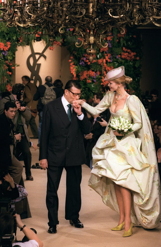 A kiss for Claudia Schiffer at the end of the catwalk after his Spring/Summer '97 haute couture presentation.