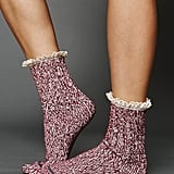 Heathered texture with a dose of girlie frill all rolled into one pair of Free People Highland boot socks ($14).