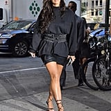 Kim Wearing a Distressed Long-Sleeved Tee and Laced Belt