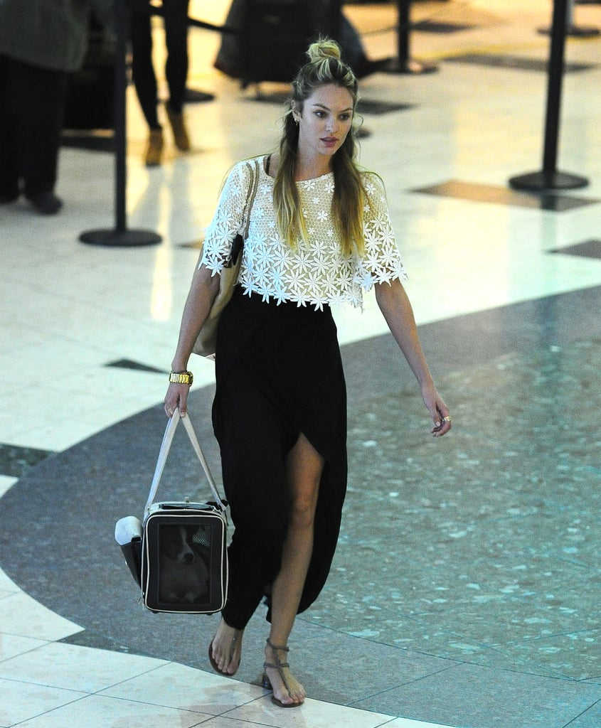 Candice Swanepoel traveled in style in a cropped lace top and black maxi skirt with a sexy slit.
