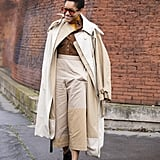 Cropped wide legs feel polished with a tailored trench and button-down shirt.