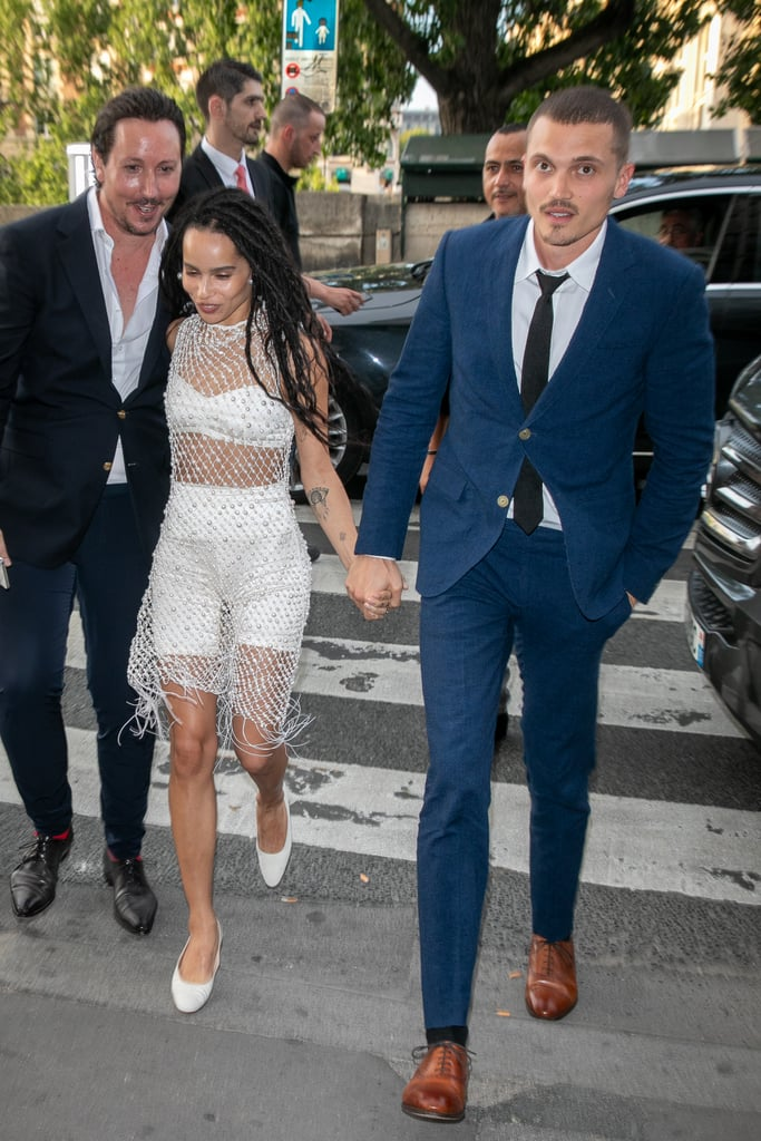 This is an understatement of epic proportions, but Zoë Kravitz is the coolest bride. Though the Big Little Lies star already married fellow actor Karl Glusman in May, a formal ceremony is set to take place in France soon. So soon, in fact, that on June 28, the couple hosted a star-studded rehearsal dinner, at which Zoë arrived looking like — we repeat — the coolest bride around. For the festivity, Zoë wore a pearl-adorned mesh dress over pearlescent bike shorts and a matching bra top. She completed the daring outfit with classic white flats and a white knot handbag by The Row. After seeing her rehearsal dinner outfit — and the chic white dress she wore to what might've been her first secret ceremony — we can't wait to see what she'll wear on the big day.       Related:                                                                                                           Zoë Kravitz's Engagement Ring Is So Huge, You Could Likely Spot It From Outer Space