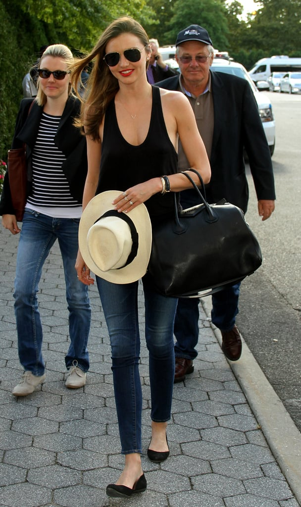 Heading to the US Open, Miranda played it casual in a black scoop tank, skinny denim, black ballet flats, and a Panama hat.