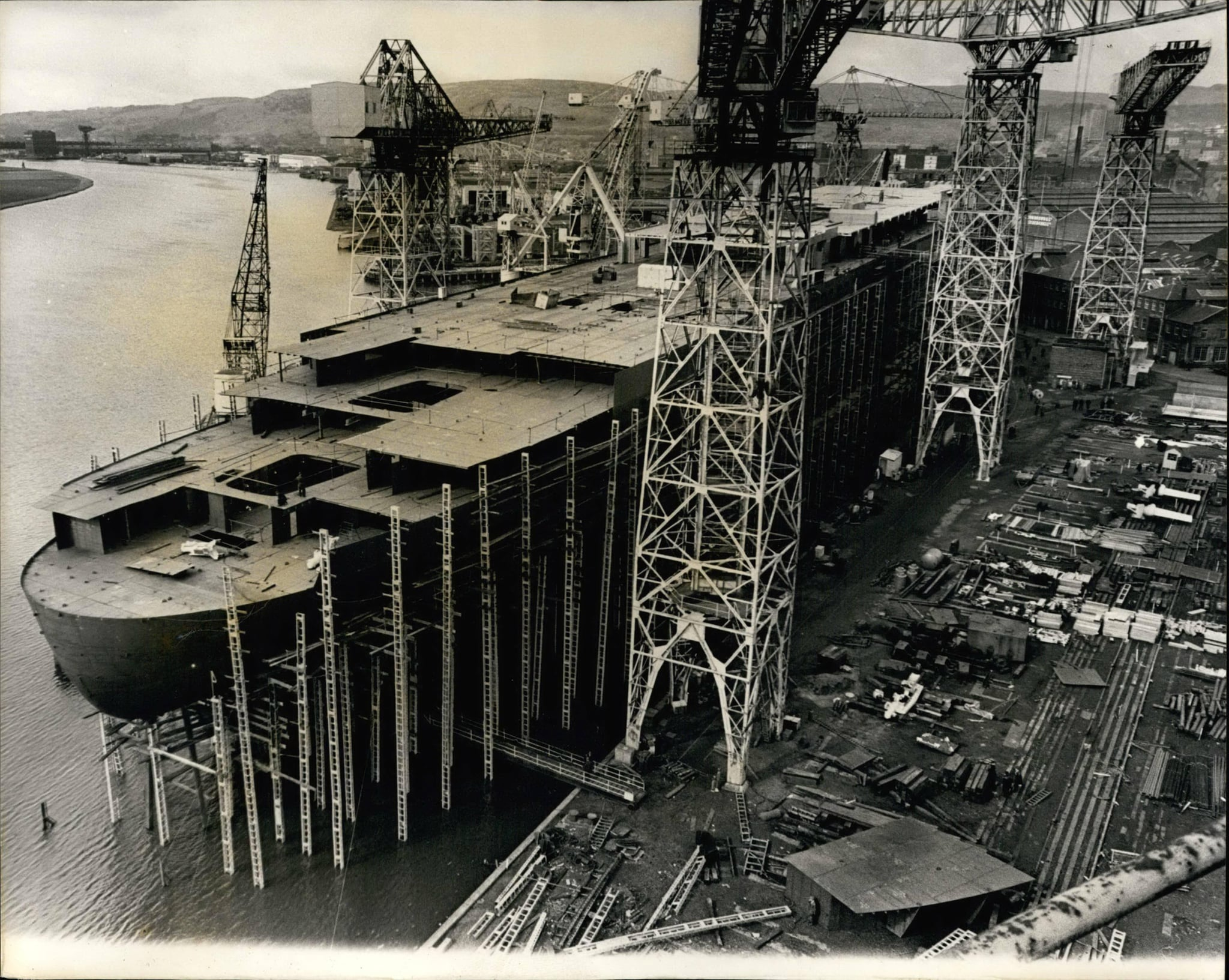 E0XKN9 Mar. 03, 1967 - The Q 4 Takes Shape: New view of the 58,000-ton liner Q.4., pictured yesterday at John Brown's shipyard, Clydebank, where she is now taking shape. the stern is almost finished and the - prefabricated decks are starting to go on top. The liner is to be launched by H.M. The Queen on September 30.
