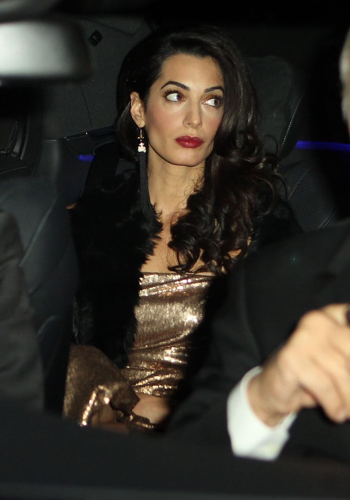 "One wedding celebration is not enough for George Clooney and Amal Alamuddin. On Saturday, the newlyweds made their way to a second party in Buckinghamshire in England just weeks after tying the knot in Italy. While their lavish wedding included George's Hollywood pals — Matt Damon, John Krasinski, Emily Blunt, and Cindy Crawford were among the stars in attendance — Saturday's party reportedly catered to more than 200 of the couple's UK friends and Amal's loved ones from Lebanon, Saudi Arabia, and Bahrain. According to the official invitation, Amal's parents, Baria and Ramzi Alamuddin, threw the bash at the historic Danesfield House. The name might undersell the spot's ambience, as the award-winning venue's website says the hotel sits ""amidst 65 acres of formal gardens with outstanding views over the River Thames and to the Chiltern Hills beyond.""  The large celebration comes after an exciting month for the newlyweds, during which George and Amal honeymooned at their new $12 million romantic estate on a private island. It didn't take long for the actor and lawyer to get back to their regular routine, though — George popped up at Comic Con in NYC to promote his upcoming movie, Tomorrowland, and Amal traveled to Athens, Greece, for work. Source: FameFlynet; Front Page"