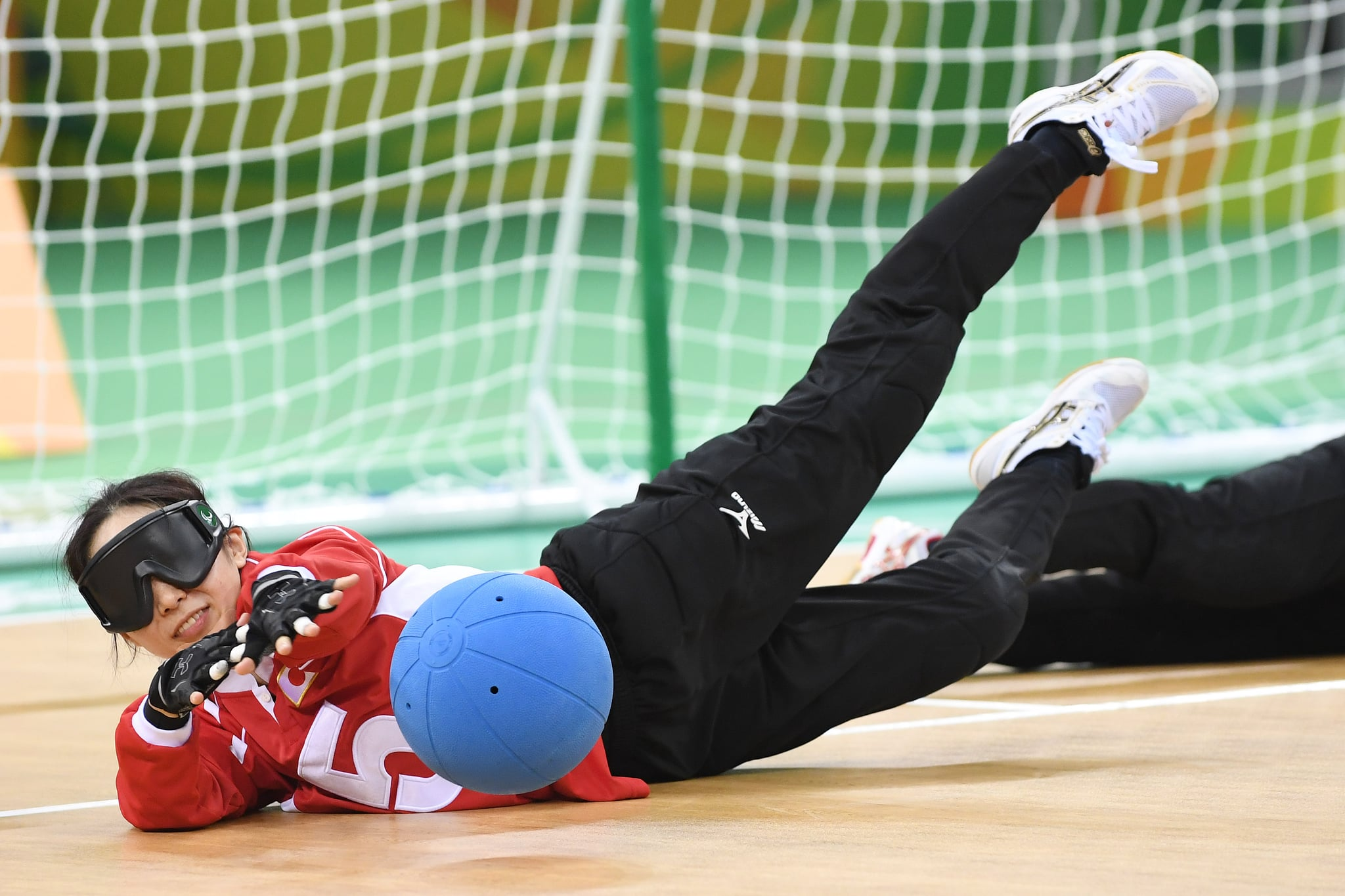 RIO DE JANEIRO, BRAZIL - SEPTEMBER 11:  Rie Urata of Japan blocks in the women's Goalball on day 4 of the Rio 2016 Paralympic Games at Future Arena on September 11, 2016 in Rio de Janeiro, Brazil.  (Photo by Atsushi Tomura/Getty Images for Tokyo 2020)