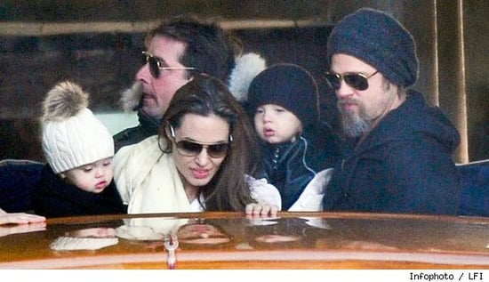 Brad and Angie getting on a water taxi with the twins in Venice,Italy