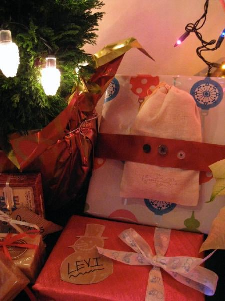 "Close up of handmade gifts; the ""button ribbon"" was a cute idea I stole from Anthropologie & I made gift tags out of TJ's bags"