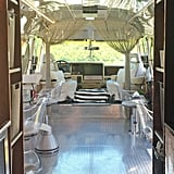 Clear chairs help make the salon appear larger. The beaded curtains by the driver and passenger's seats lend a mid-century vibe.