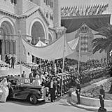 """Nearly 2,000 journalists packed into Monaco for the wedding. Every newspaper in the world wanted their top reporters covering the """"wedding of the century,"""" but Monaco was unprepared for the onslaught of the press. A local school had been converted into a makeshift press center, equipped with new typewriters and phone booths, but reporters complained that the arrangements were sorely lacking.  They got married not once but twice. Due to Napoleonic Code and Roman Catholic church rules, Grace and Prince Rainier had to marry in both a civil ceremony on April 18 and a religious ceremony the day afterward. The first was only 15 minutes long and was conducted in the Palace Throne Room. Grace received more than 140 titles upon its completion, which then took another 25 minutes to read aloud.  Only two dozen reporters were allowed to cover the actual ceremony. Although Grace and Prince Rainier welcomed a handful into their nuptials, most were kept waiting for shreds of news outside the palace.  MGM planned the entire event. The Hollywood studio Grace worked for, Metro-Goldwyn-Mayer, oversaw everything from Grace's dress to the lighting inside the cathedral and later put all the footage of the event together for a movie about her wedding. One of Grace's bridesmaids later remarked, """"The day, like the bride-to-be herself, was a creation brought to us through the joint production efforts of enormous willpower, Metro-Goldwyn-Mayer, and God.""""   There was a dress rehearsal of the wedding days before the actual ceremony. MGM had technicians hold a dress rehearsal of the ceremony to ensure lighting and sound were up to snuff. They also had a team of the studio's best hair and makeup staff accompany Kelly on the Constitution and into Monaco afterward so that she was always camera-ready."""