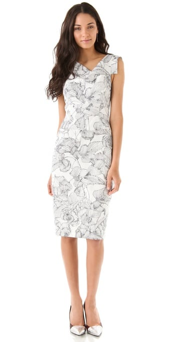 If you've got a brunch with family and friends to celebrate your first day as man and wife, then step out in style with a fitted sheath like this that's pretty but also subtly sexy.  Black Halo Floral Jackie O Dress ($390)