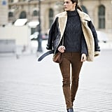 Alessandra Ambrosio wearing an Acne coat, Magda Butrym pants, Linda Farrow sunglasses, and a Chloé bag.