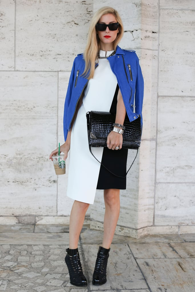 Joanna Hillman added interest to a white-and-black sheath with a bold, blue-hued leather topper and a pair of seriously cool Fall ankle boots.