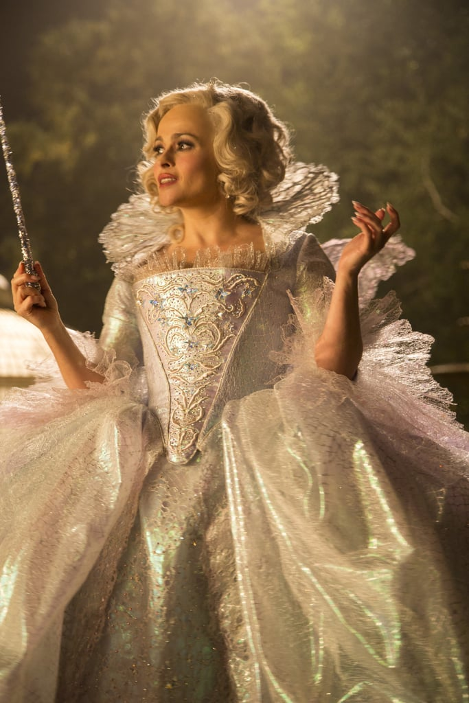 She meets a fairy godmother (Helena Bonham Carter), who helps transform her.