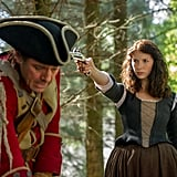 Claire takes aim at an English soldier.