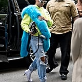 Back in May 2017, Rihanna paired a furry blue stole with her neon green hoodie, ripped jeans, and white boots. Only she could pull off this look with so much coolness.