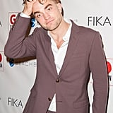 Despite having shaved half his head, Rob still had enough hair to run his fingers through at a Beverly Hills event in November 2014.