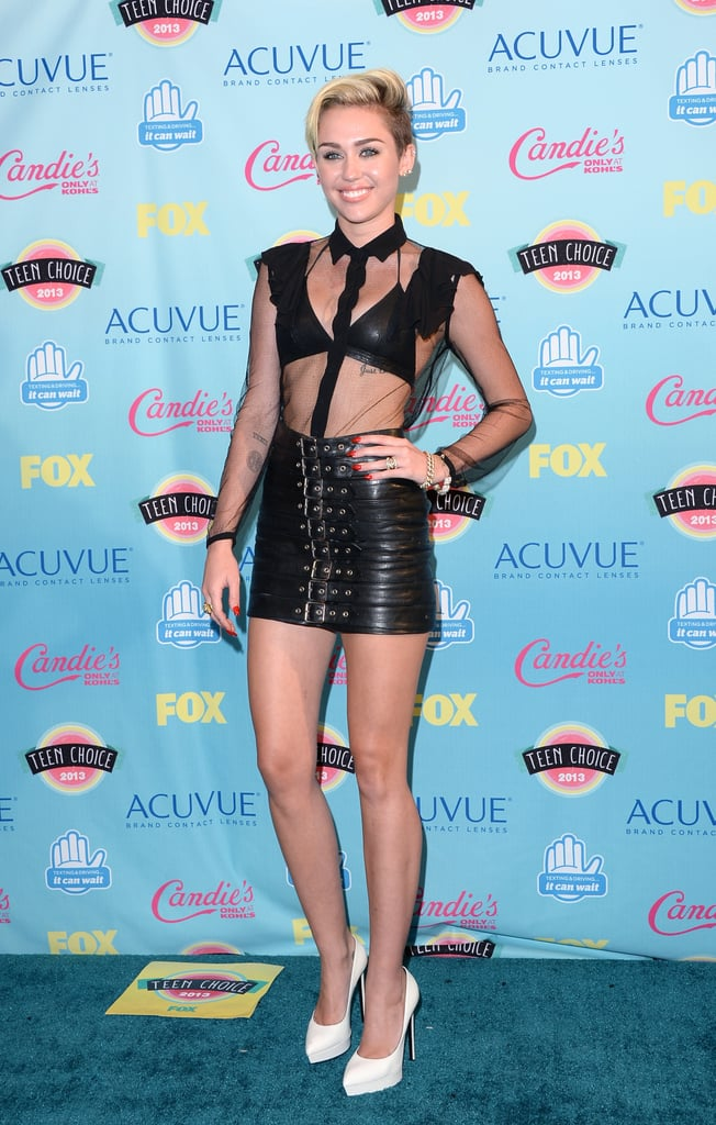 Miley showed lots of skin in a bondage-inspired Saint Laurent outfit at the Teen Choice Awards on Aug. 11.