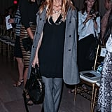 Rachel Zoe suited up (and kept her shades on) in Marchesa's front row.