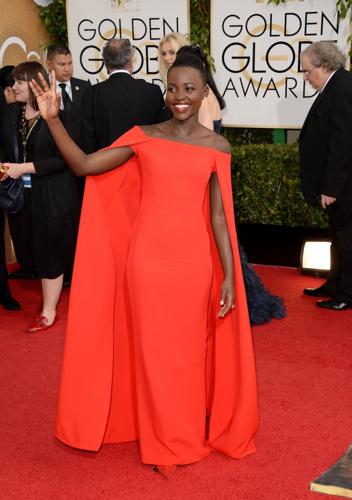 Lupita Nyong'o was gorgeous in red as she waved to the crowds outside.