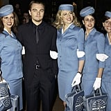 Leo stood with a gaggle of retro-chic flight attendants at the January 2003 UK premiere of Catch Me If You Can.