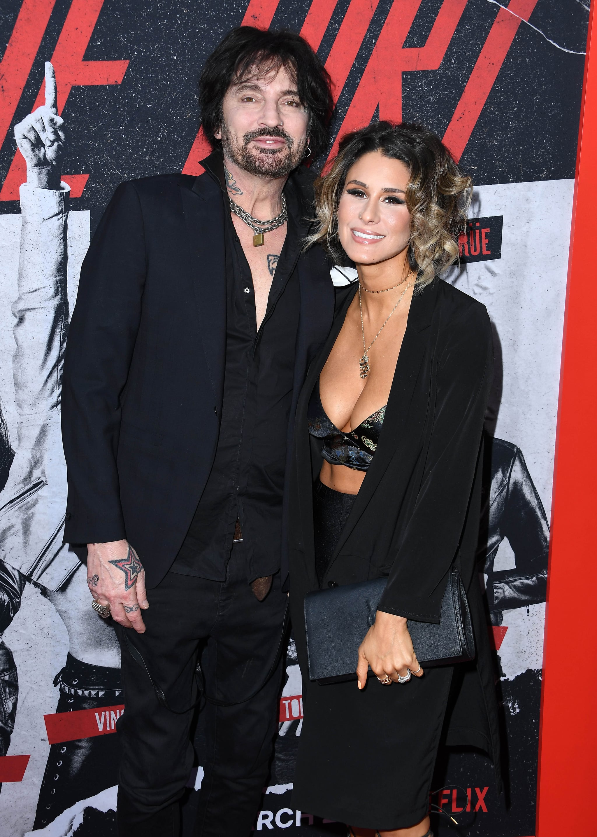 HOLLYWOOD, CALIFORNIA - MARCH 18: Tommy Lee and Brittany Furlan arrive at the Premiere Of Netflix's