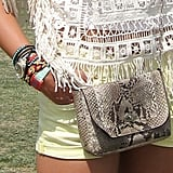 We love the textural intrigue of this snake-print crossbody bag and the awesome wrist full of bracelets.