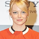 Emma Stone wore an orange dress for the press conference for The Amazing Spider-Man in Japan.