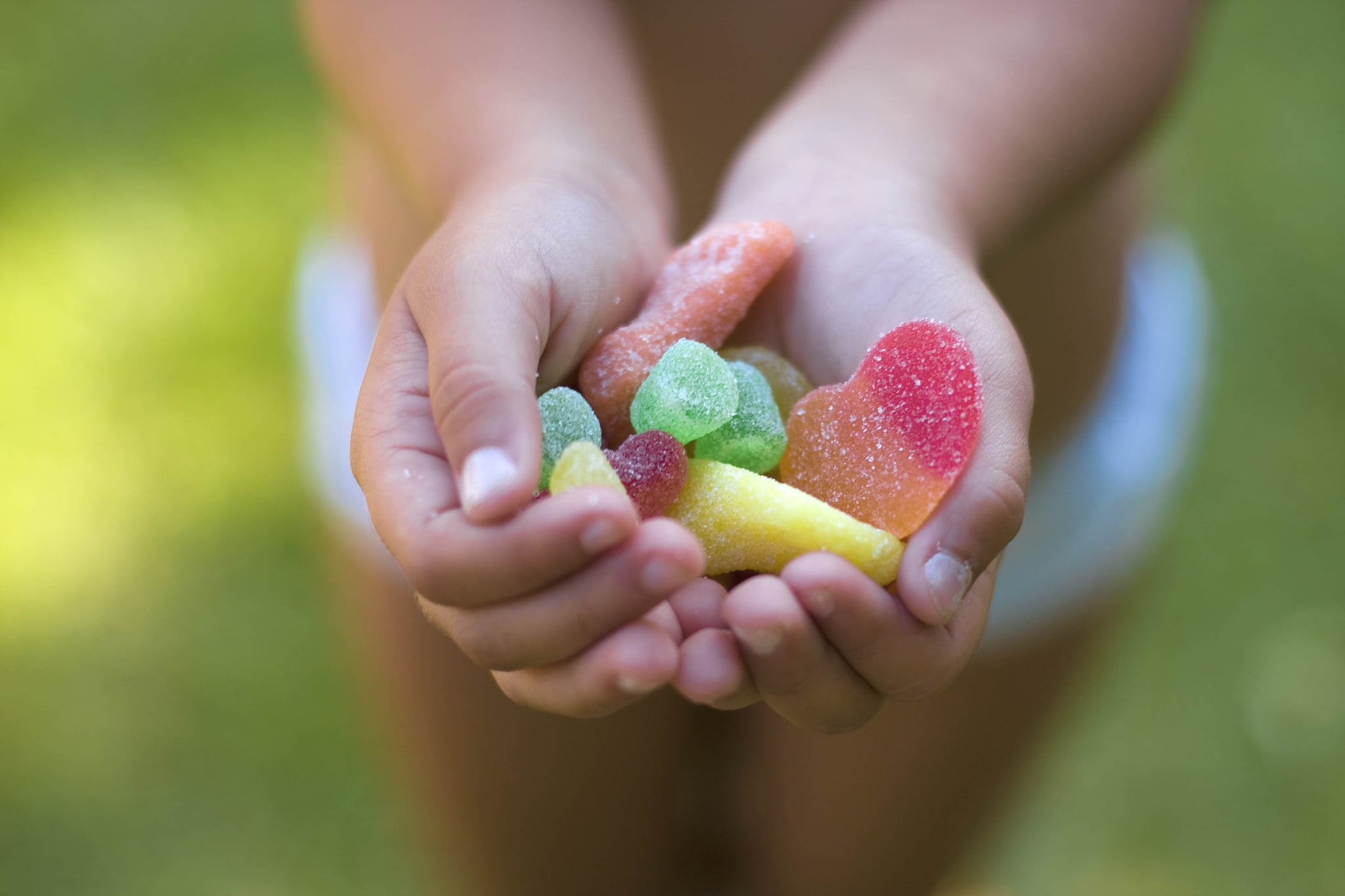 a small girl with candy in her hands.