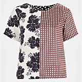 I'm all about mixing prints, and this Topshop Half & Half Mix Print Tee ($64) takes the work out of it! Just pair it with dark denim now or white denim in the Summer, and you are totally done.  — Melissa Liebling-Goldberg, Fashion & Beauty director