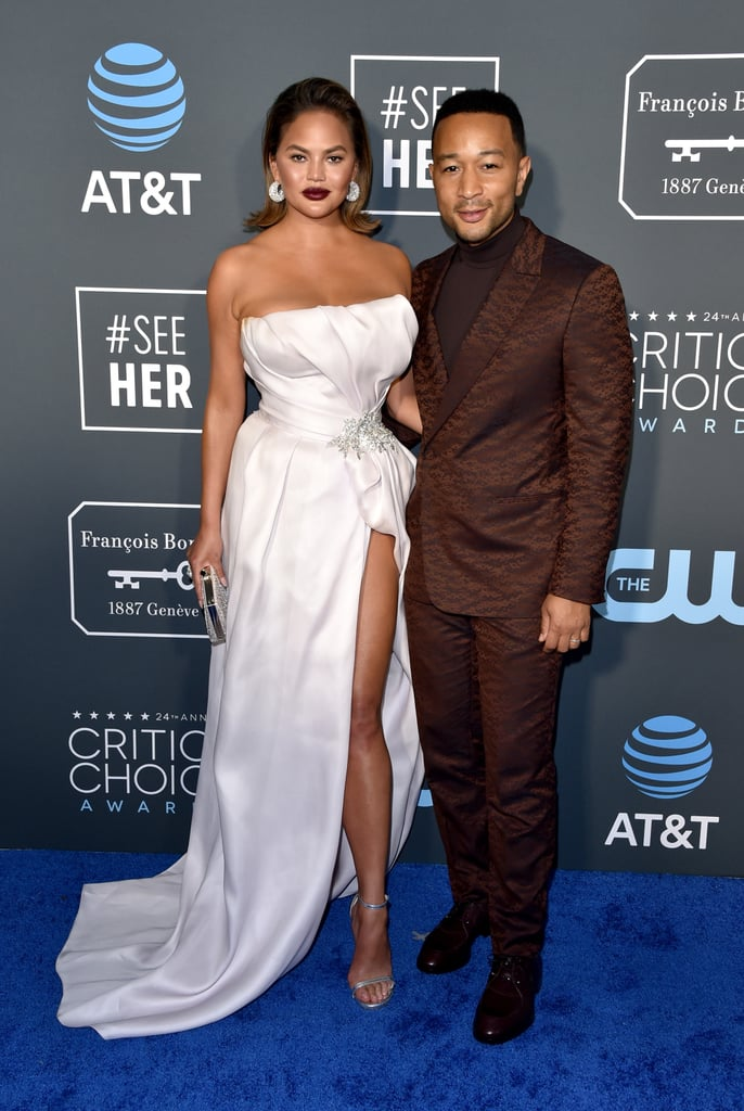 "It's a feeling we all know far too well: you agree to plans in advance and when the time finally comes, you're filled with deep regret. Chrissy Teigen and John Legend dealt with a heavy dose of said regret during Sunday night's Critics' Choice Awards. While many of us nursed our weekend hangovers on the couch alongside a big bottle of Gatorade, Chrissy and John got back into their finery and faced the wrath of the previous night's festivities on the red carpet. Just hours prior, the duo celebrated John's 40th birthday with a star-studded Casino Royale party. Ahead of Sunday night's show, Chrissy shared hilarious videos noting that ""this was a huge mistake."" ""Why oh why god did I agree to the people or critics choice whatever it is the night after John's party this was a big mistake huge yes this is a fancy problem,"" she wrote, also sharing a video of John watching the Eagles vs. Saints football game. John is nominated for best actor in a movie made for TV or limited series for his role on Jesus Christ Superstar Live in Concert. We have to say, for someone who's probably in need of a Glacier Freeze Gatorade, Chrissy looks stunning! See photos from John and Chrissy's night out ahead.      Related:                                                                                                           Presenting the 2019 Critics' Choice Awards Winners, So Far"