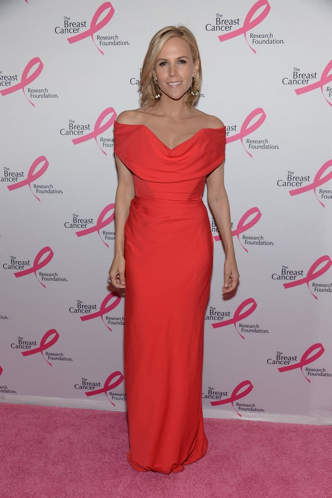 Tory Burch made an elegant arrival at the Hot Pink Party in a bright, off-the-shoulder gown.