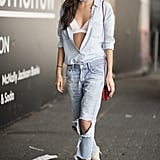 Sara Sampaio tweaked her denim-on-denim look by leaving her top unbuttoned to expose a white bralette. A bandana made the outfit street style ready.