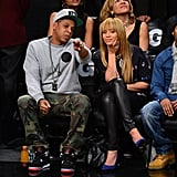 Jay-Z chatted with wife Beyonce Knowles at the Knicks game in NYC.