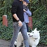 Jennifer Aniston and Justin Theroux walking with Dolly.