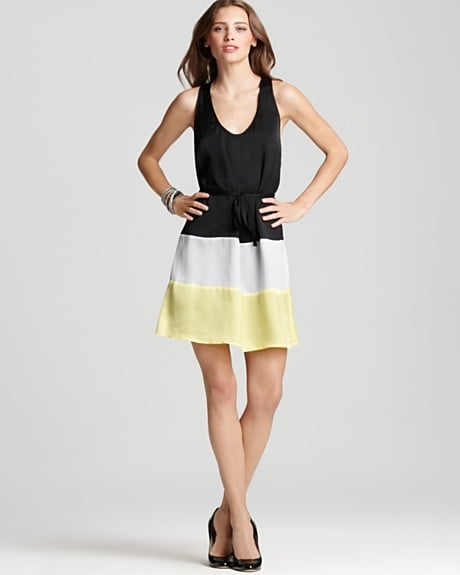 Thanks to the smart color combo, we love this slimming colorblock dress.  Aqua Color Block Tie Waist Dress ($88)