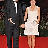John C. Reilly and Alison Dickey were hand in hand.