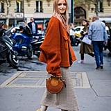 Style a Burnt-Orange Jacket With a Checkered Midi Skirt