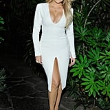 Khloé Kardashian stuck to the Easter theme and rocked a long-sleeved body-con minidress with a plunging neckline and a superhigh leg slit. She added a dainty chain necklace then turned up the edge with chunky gold rings and embellished white sandals.