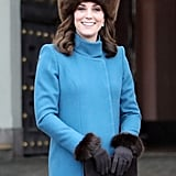 During a day out in Norway, Kate wore a sleek cerulean Catherine Walker coat, which she accessorized with a fuzzy brown Lacorine hat.